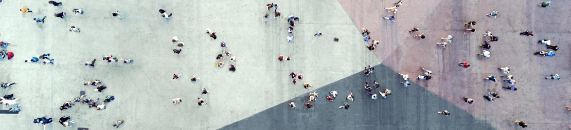 Top-down view of people walking on plaza